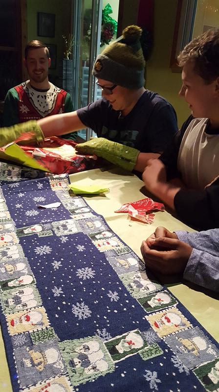 Jayden unwrapping gift